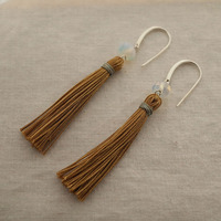 Thumb pierce tassel
